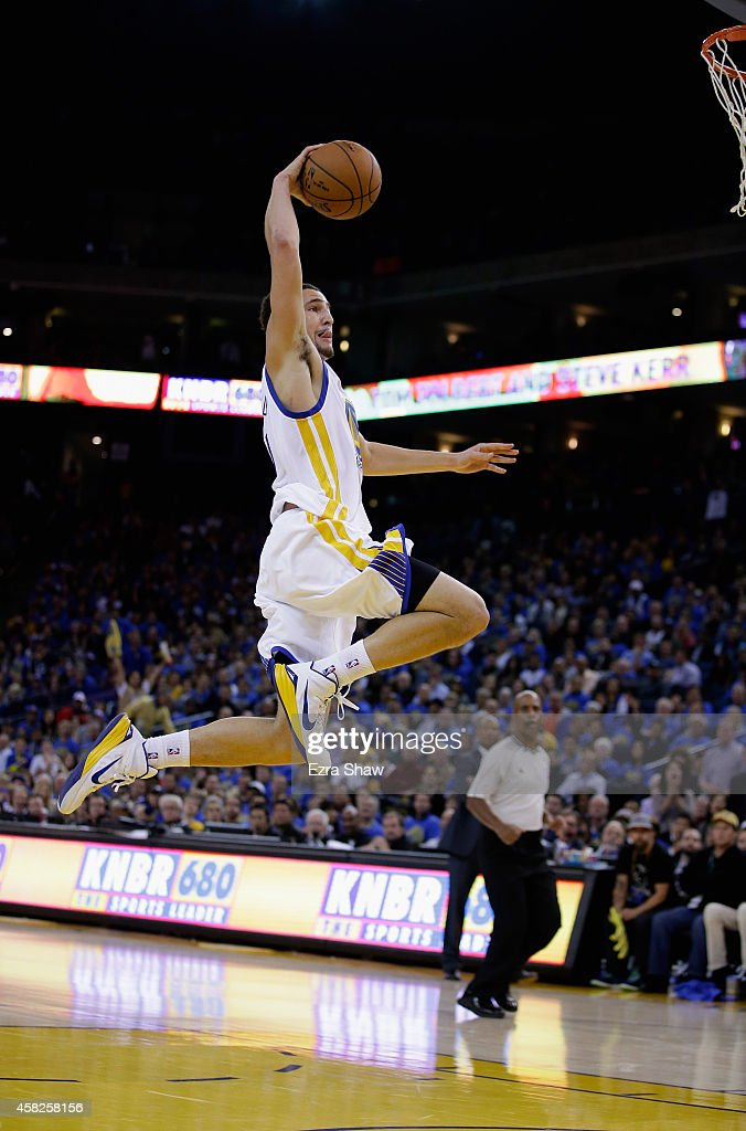 <a gi-track='captionPersonalityLinkClicked' href=/galleries/search?phrase=Klay+Thompson&family=editorial&specificpeople=5132325 ng-click='$event.stopPropagation()'>Klay Thompson</a> #11 of the Golden State Warriors goes up for a dunk against the Los Angeles Lakers at ORACLE Arena on November 1, 2014 in Oakland, California.