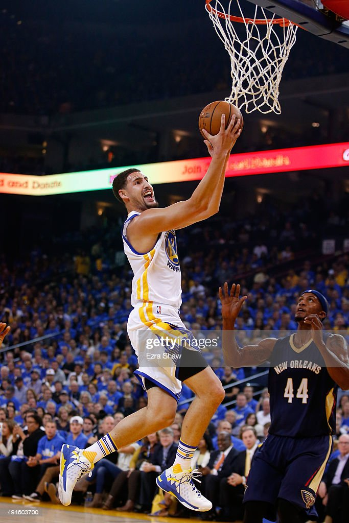Klay Thompson #11 of the Golden State Warriors goes up for a layup gainst Dante Cunningham #44 of the New Orleans Pelicans during the NBA season opener at ORACLE Arena on October 27, 2015 in Oakland, California.