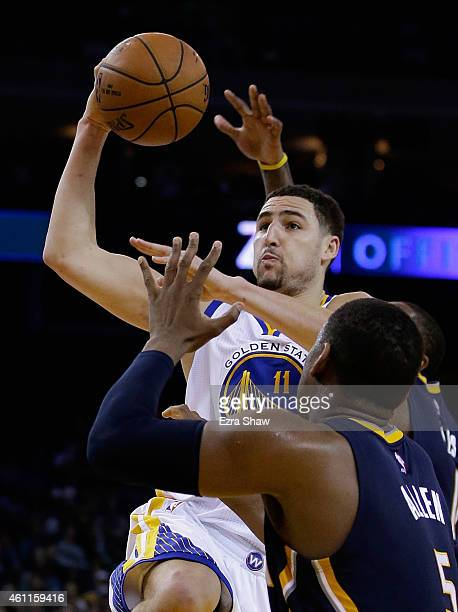 Klay Thompson of the Golden State Warriors goes up for a shot against Lavoy Allen of the Indiana Pacers at ORACLE Arena on January 7 2015 in Oakland...