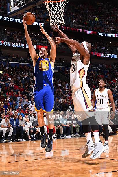 Klay Thompson of the Golden State Warriors goes up for a shot against Dante Cunningham of the New Orleans Pelicans during a game at Smoothie King...