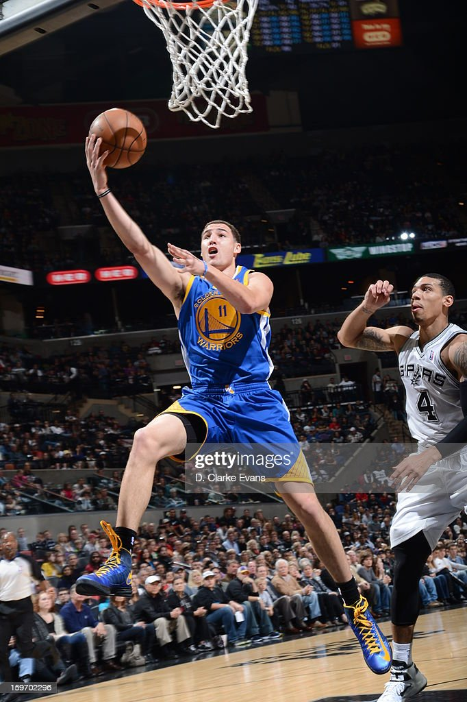 <a gi-track='captionPersonalityLinkClicked' href=/galleries/search?phrase=Klay+Thompson&family=editorial&specificpeople=5132325 ng-click='$event.stopPropagation()'>Klay Thompson</a> #11 of the Golden State Warriors goes up for the layup in a game on January 18, 2013 at the AT&T Center in San Antonio, Texas.