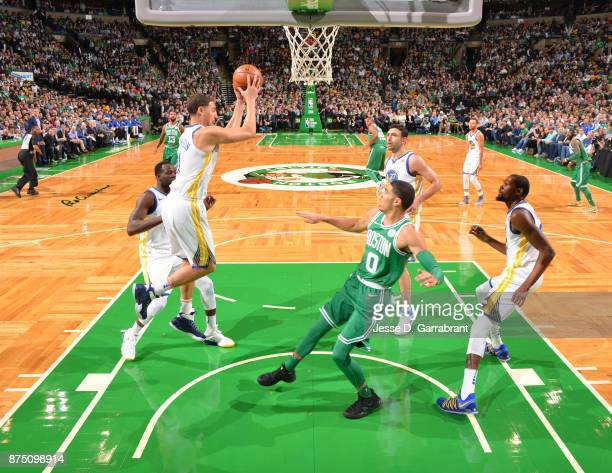 Klay Thompson of the Golden State Warriors goes up for the rebound during the game against the Boston Celtics on November 16 2017 at the TD Garden in...