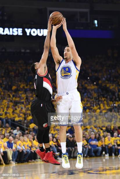 Klay Thompson of the Golden State Warriors goes up to shoot and has his shot blocked by CJ McCollum of the Portland Trail Blazers in the first...