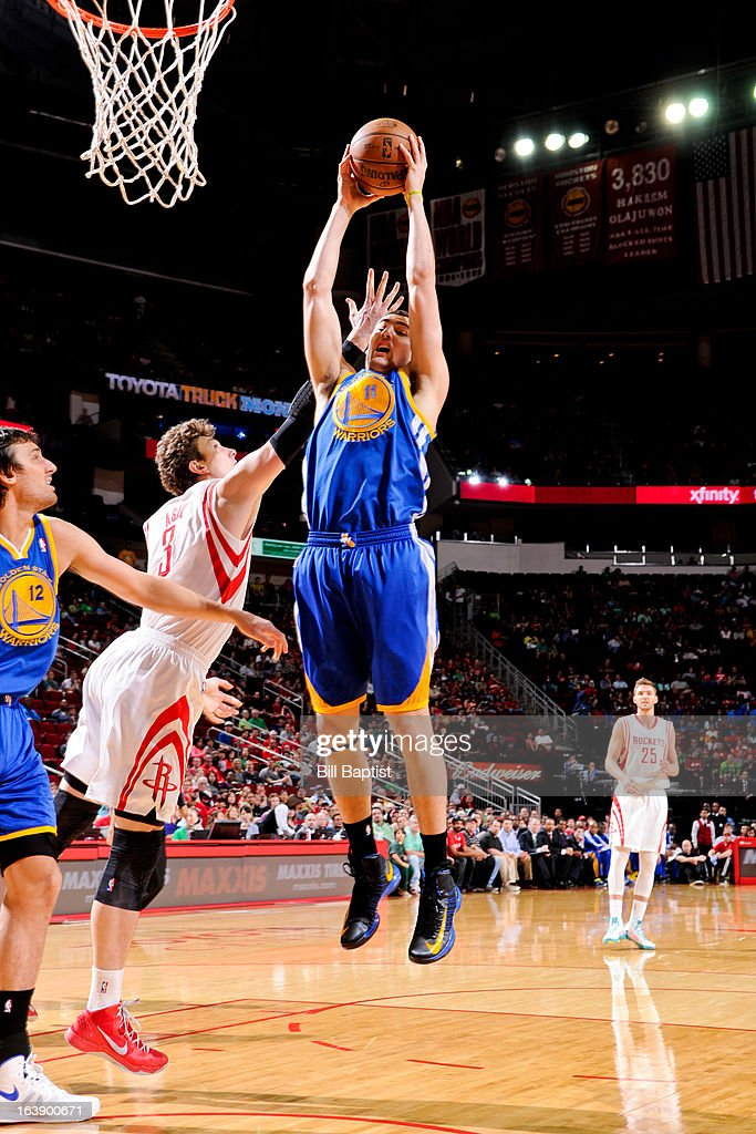 Klay Thompson #11 of the Golden State Warriors grabs a rebound against Omer Asik #3 of the Houston Rockets on March 17, 2013 at the Toyota Center in Houston, Texas.