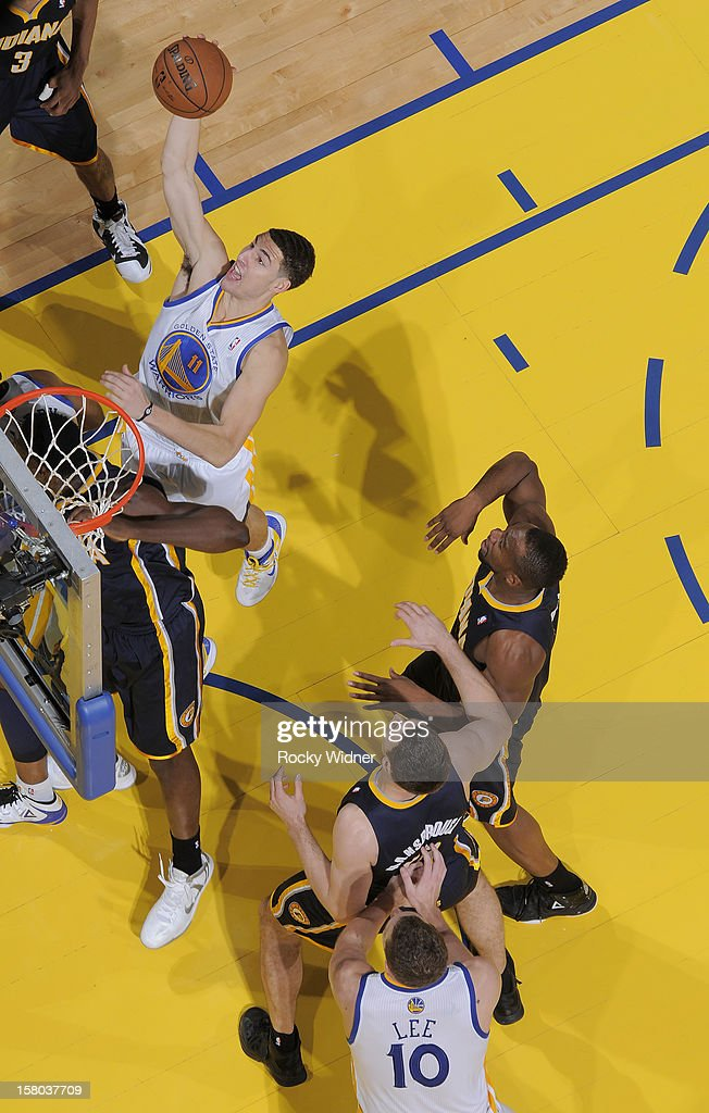 <a gi-track='captionPersonalityLinkClicked' href=/galleries/search?phrase=Klay+Thompson&family=editorial&specificpeople=5132325 ng-click='$event.stopPropagation()'>Klay Thompson</a> #11 of the Golden State Warriors grabs the rebound against the Indiana Pacers on December 1, 2012 at Oracle Arena in Oakland, California.