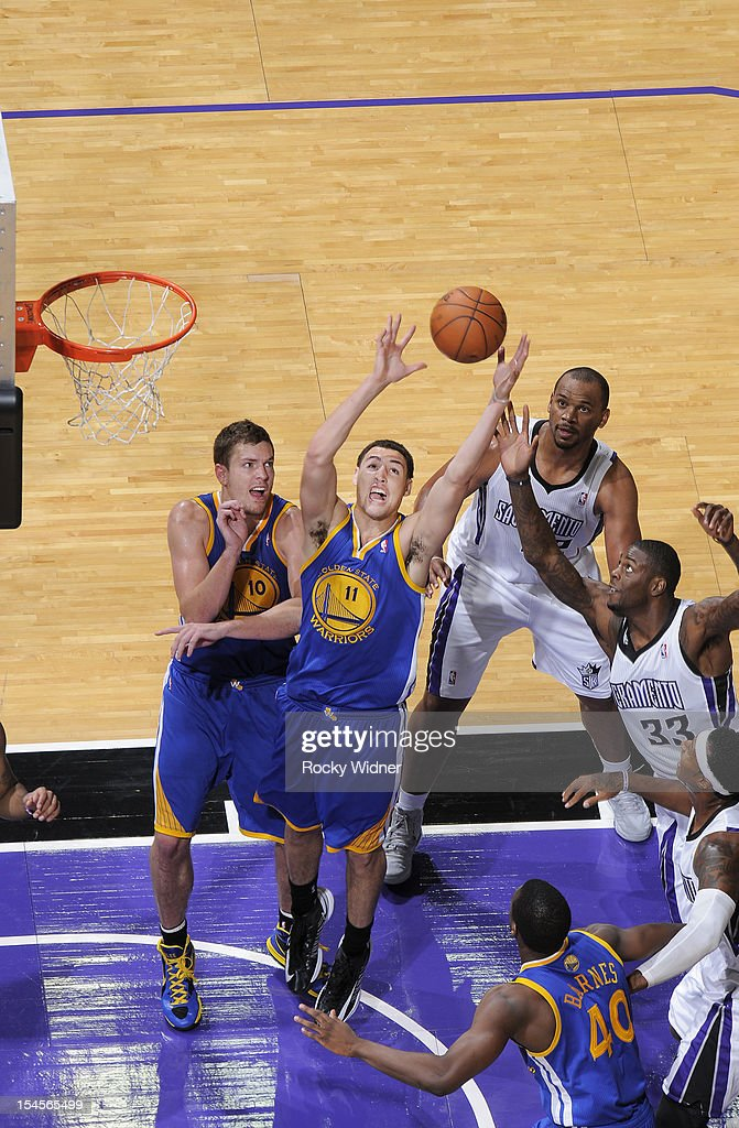 Klay Thompson #11 of the Golden State Warriors grabs the rebound away from Willie Reed #33 of the Sacramento Kings on October 17, 2012 at Power Balance Pavilion in Sacramento, California.