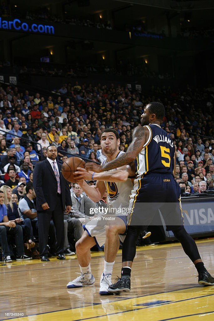 <a gi-track='captionPersonalityLinkClicked' href=/galleries/search?phrase=Klay+Thompson&family=editorial&specificpeople=5132325 ng-click='$event.stopPropagation()'>Klay Thompson</a> of the Golden State Warriors handles the ball against Mo Williams #5 of the Utah Jazz on April 7, 2013 at Oracle Arena in Oakland, California.