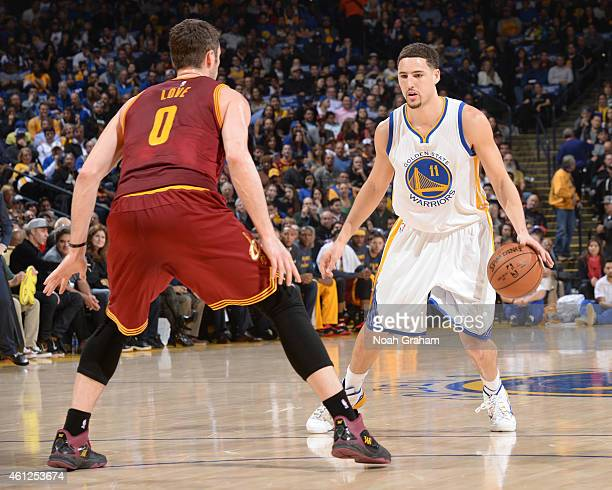 Klay Thompson of the Golden State Warriors handles the ball against the Cleveland Cavaliers on January 9 2015 at Oracle Arena in Oakland California...