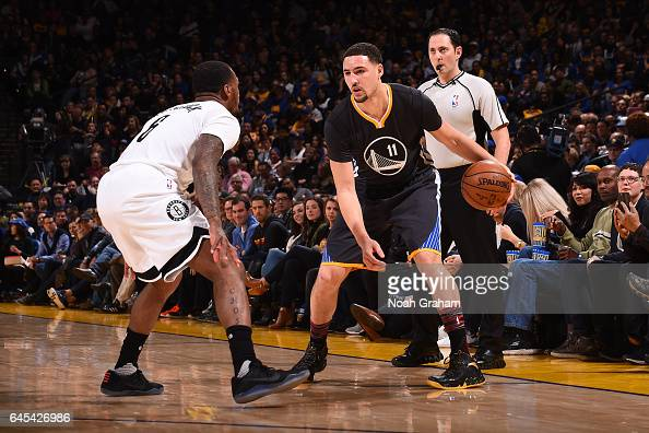 Klay Thompson of the Golden State Warriors handles the ball against the Brooklyn Nets on February 25 2017 at ORACLE Arena in Oakland California NOTE...