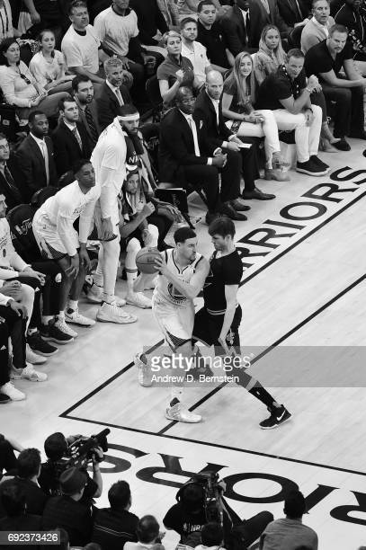 Klay Thompson of the Golden State Warriors handles the ball against Kyle Korver of the Cleveland Cavaliers in Game Two of the 2017 NBA Finals on June...