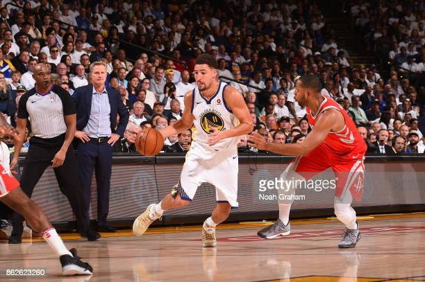 Klay Thompson of the Golden State Warriors handles the ball against the Houston Rockets on October 17 2017 at ORACLE Arena in Oakland California NOTE...