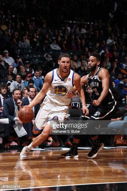 Klay Thompson of the Golden State Warriors handles the ball against the Brooklyn Nets on November 19 2017 at Barclays Center in Brooklyn New York...