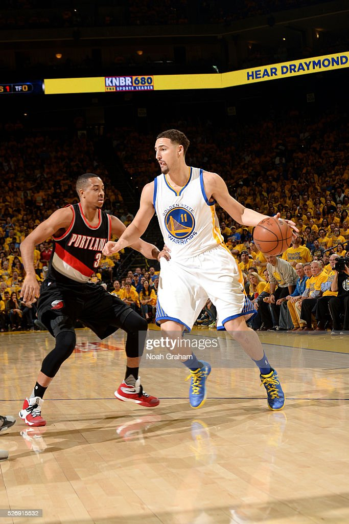 Klay Thompson #11 of the Golden State Warriors handles the ball during the game against C.J. McCollum #3 of the Portland Trail Blazers in Game One of the Western Conference Semifinals during the 2016 NBA Playoffs on May 1, 2016 at ORACLE Arena in Oakland, California.