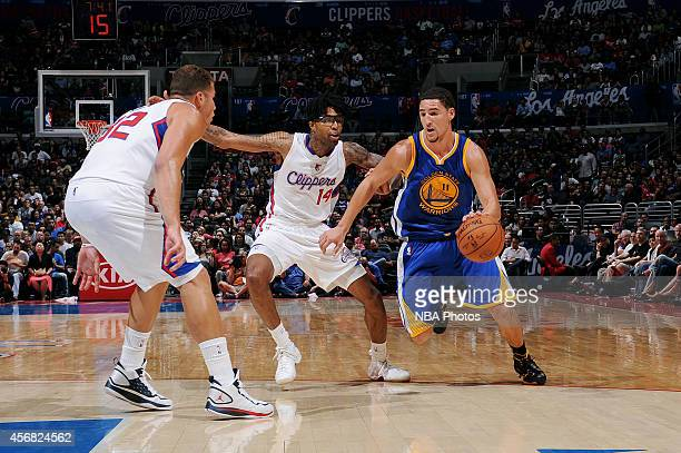 Klay Thompson of the Golden State Warriors handles the basketball against Chris DouglasRoberts of the Los Angeles Clippers on October 7 2014 at the...