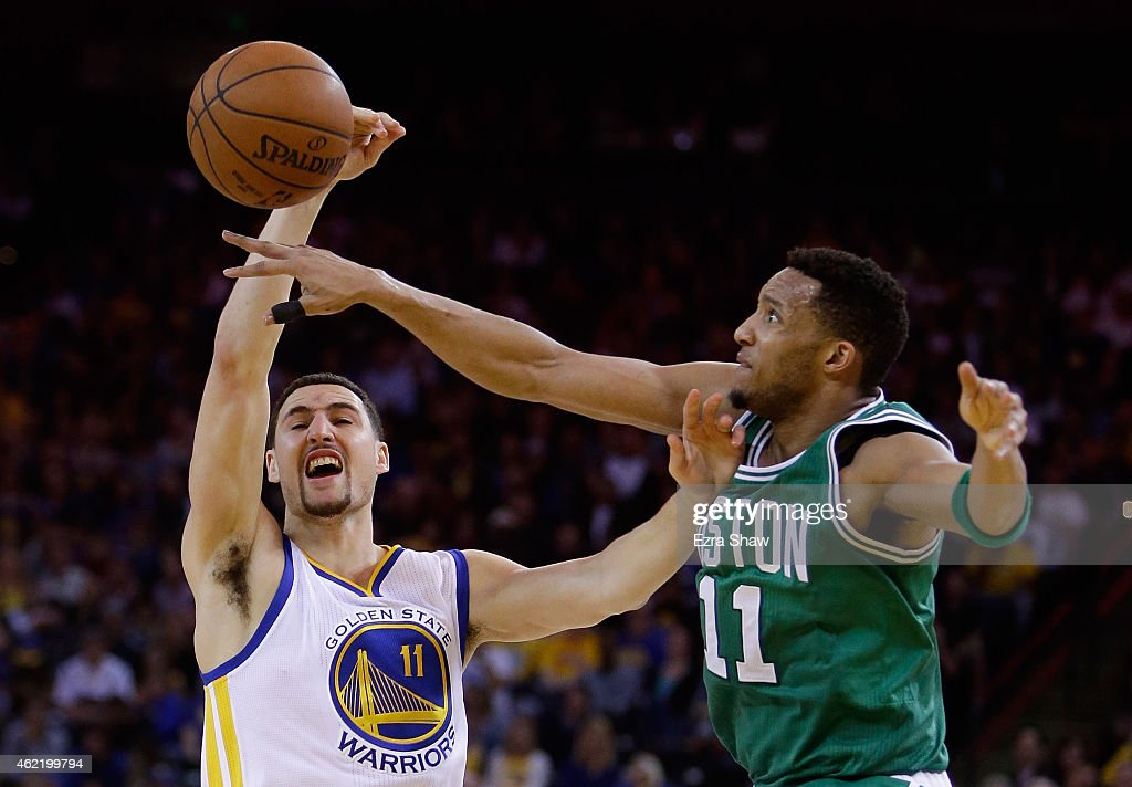 Klay Thompson #11 of the Golden State Warriors has a shot blocked by Evan Turner #11 of the Boston Celtics at ORACLE Arena on January 25, 2015 in Oakland, California.