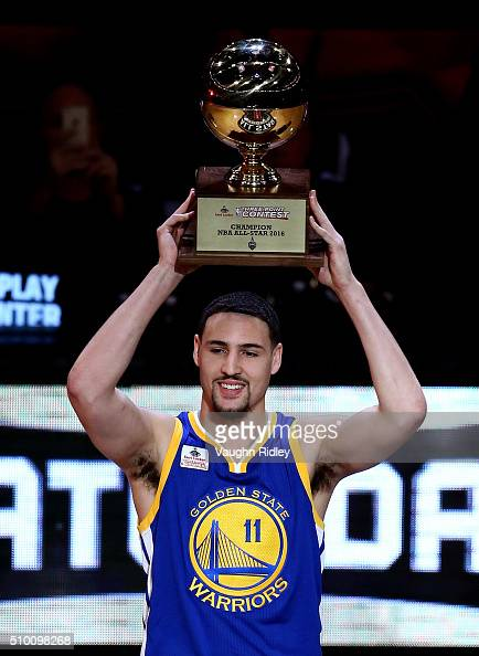 Klay Thompson of the Golden State Warriors holds up the trophy after winning the Foot Locker ThreePoint Contest during NBA AllStar Weekend 2016 at...
