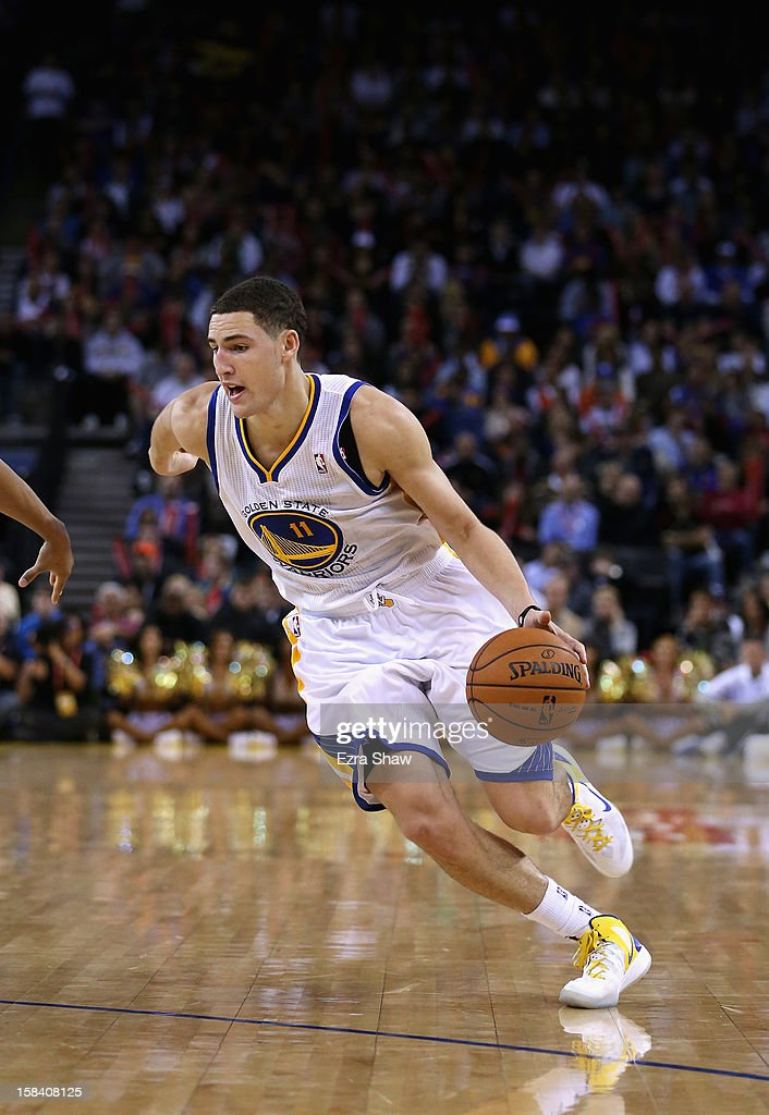 <a gi-track='captionPersonalityLinkClicked' href=/galleries/search?phrase=Klay+Thompson&family=editorial&specificpeople=5132325 ng-click='$event.stopPropagation()'>Klay Thompson</a> #11 of the Golden State Warriors in action against the Denver Nuggets at Oracle Arena on November 29, 2012 in Oakland, California.