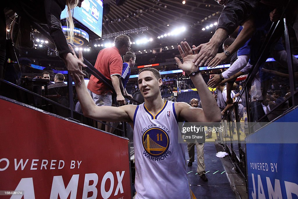 <a gi-track='captionPersonalityLinkClicked' href=/galleries/search?phrase=Klay+Thompson&family=editorial&specificpeople=5132325 ng-click='$event.stopPropagation()'>Klay Thompson</a> #11 of the Golden State Warriors is congratulated by fans as he heads back to the lockerroom after they beat the Denver Nuggets at Oracle Arena on November 29, 2012 in Oakland, California.