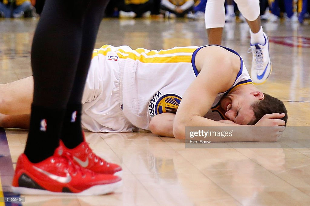 <a gi-track='captionPersonalityLinkClicked' href=/galleries/search?phrase=Klay+Thompson&family=editorial&specificpeople=5132325 ng-click='$event.stopPropagation()'>Klay Thompson</a> #11 of the Golden State Warriors is injured in the fourth quarter against the Houston Rockets during game five of the Western Conference Finals of the 2015 NBA Playoffs at ORACLE Arena on May 27, 2015 in Oakland, California.