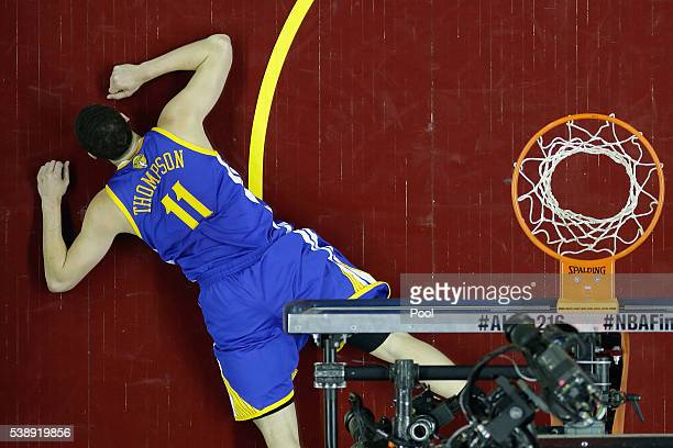 Klay Thompson of the Golden State Warriors lies on the court during the second half against the Cleveland Cavaliers in Game 3 of the 2016 NBA Finals...