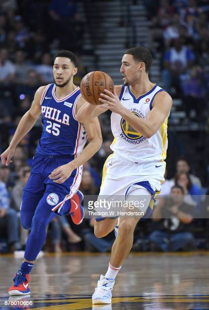 Klay Thompson of the Golden State Warriors looks to pass the ball against the Philadelphia 76ers during an NBA basketball game at ORACLE Arena on...