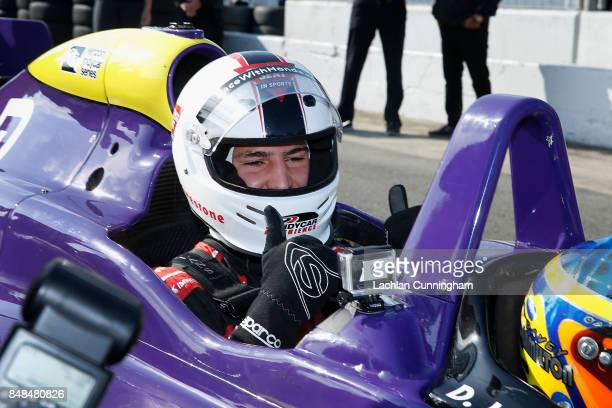 Klay Thompson of the Golden State Warriors NBA team gives thumbs up before a ride in a twoseat IndyCar with driver Davey Hamilton on day 3 of the...