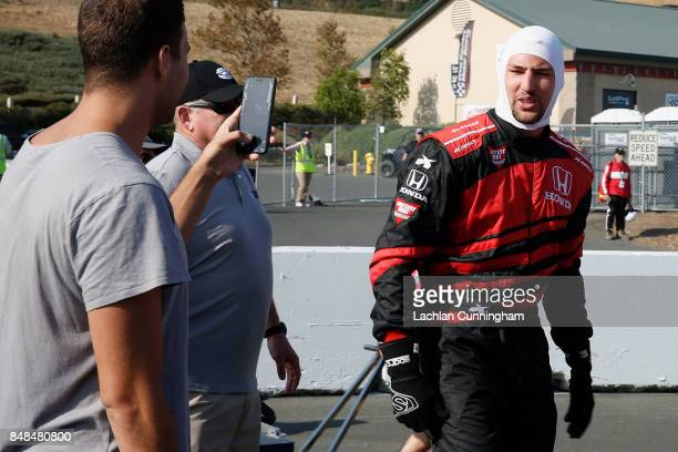 Klay Thompson of the Golden State Warriors NBA team reacts after a ride in a twoseat IndyCar with driver Davey Hamilton on day 3 of the GoPro Grand...