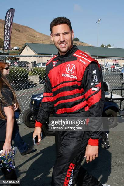 Klay Thompson of the Golden State Warriors NBA team walks to the track for a ride in a twoseat IndyCar with driver Davey Hamilton on day 3 of the...