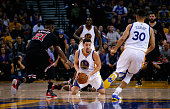 Klay Thompson of the Golden State Warriors passes the ball to Stephen Curry while Jimmy Butler of the Chicago Bulls plays defense at ORACLE Arena on...