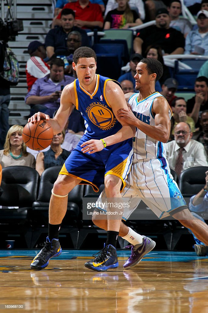 Klay Thompson #11 of the Golden State Warriors posts-up against Brian Roberts #22 of the New Orleans Hornets on March 18, 2013 at the New Orleans Arena in New Orleans, Louisiana.