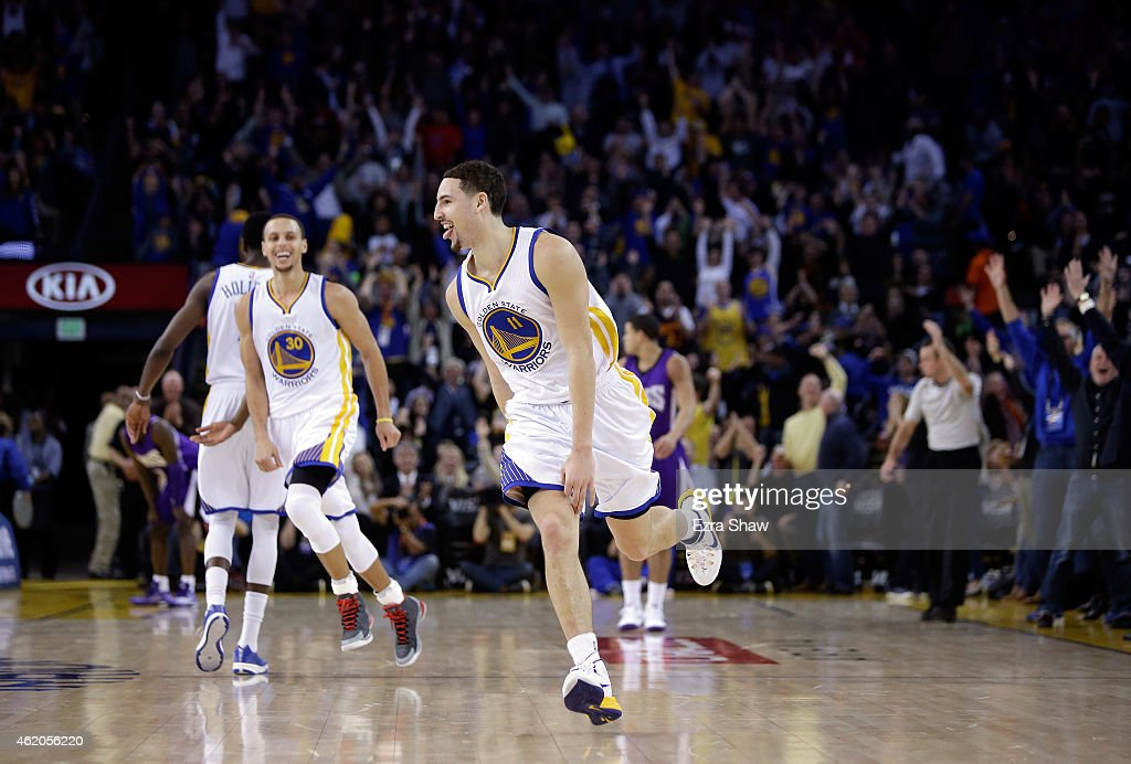 <a gi-track='captionPersonalityLinkClicked' href=/galleries/search?phrase=Klay+Thompson&family=editorial&specificpeople=5132325 ng-click='$event.stopPropagation()'>Klay Thompson</a> #11 of the Golden State Warriors reacts after he made a three-point basket in the third quarter of their game against the Sacramento Kings at ORACLE Arena on January 23, 2015 in Oakland, California. Thompson scored 37 points in the third quarter to set a NBA record.