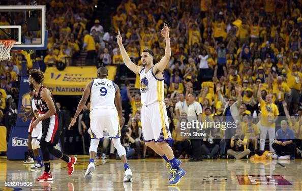 Klay Thompson of the Golden State Warriors reacts after he made a threepoint basket at the end of the first quarter against the Portland Trail...