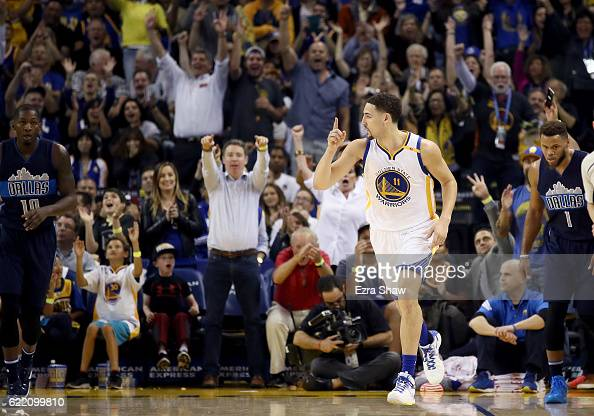 Klay Thompson of the Golden State Warriors reacts after making a threepoint basket against the Dallas Mavericks at ORACLE Arena on November 9 2016 in...