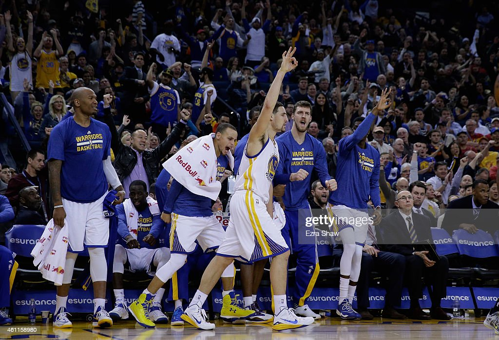 <a gi-track='captionPersonalityLinkClicked' href=/galleries/search?phrase=Klay+Thompson&family=editorial&specificpeople=5132325 ng-click='$event.stopPropagation()'>Klay Thompson</a> #11 of the Golden State Warriors reacts with the bench players including <a gi-track='captionPersonalityLinkClicked' href=/galleries/search?phrase=Stephen+Curry+-+Basketball+Player&family=editorial&specificpeople=5040623 ng-click='$event.stopPropagation()'>Stephen Curry</a> #30 after he made a three-point basket against the Indiana Pacers at ORACLE Arena on January 7, 2015 in Oakland, California.