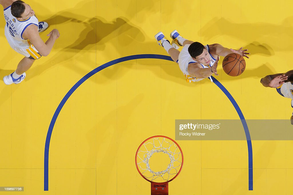 <a gi-track='captionPersonalityLinkClicked' href=/galleries/search?phrase=Klay+Thompson&family=editorial&specificpeople=5132325 ng-click='$event.stopPropagation()'>Klay Thompson</a> #11 of the Golden State Warriors rebounds against the Memphis Grizzlies on January 9, 2013 at Oracle Arena in Oakland, California.