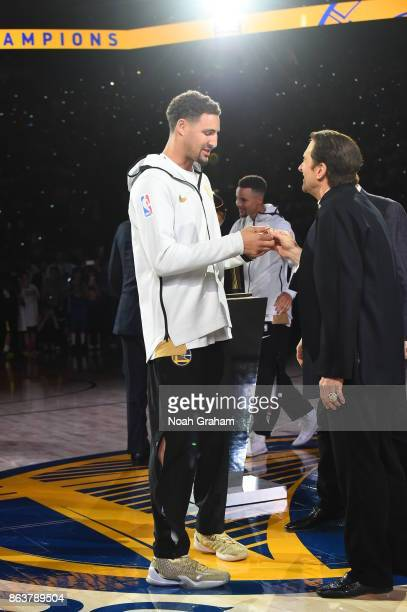 Klay Thompson of the Golden State Warriors receives his rings during the NBA Championship ring ceremony before the game against the Houston Rockes on...