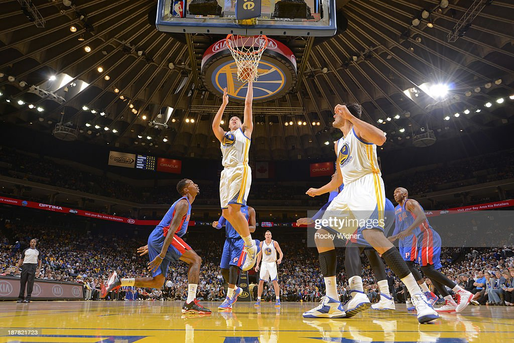 Klay Thompson #11 of the Golden State Warriors shoots a layup against Brandon Jennings #7 of the Detroit Pistons on November 12, 2013 at Oracle Arena in Oakland, California.