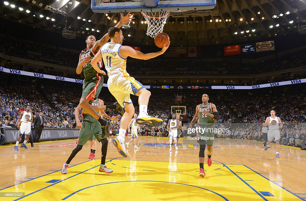 <a gi-track='captionPersonalityLinkClicked' href=/galleries/search?phrase=Klay+Thompson&family=editorial&specificpeople=5132325 ng-click='$event.stopPropagation()'>Klay Thompson</a> #11 of the Golden State Warriors shoots a layup against John Henson #31 of the Milwaukee Bucks on March 20, 2014 at Oracle Arena in Oakland, California.