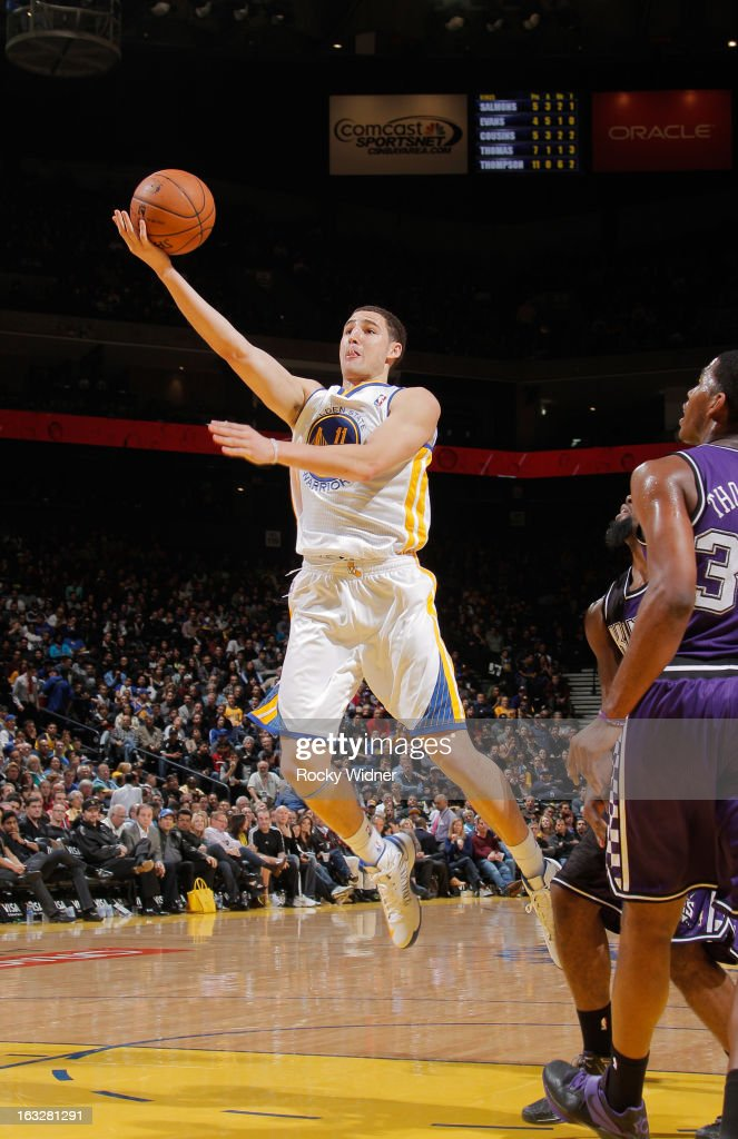 Klay Thompson #11 of the Golden State Warriors shoots a layup against the Sacramento Kings on March 6, 2013 at Oracle Arena in Oakland, California.