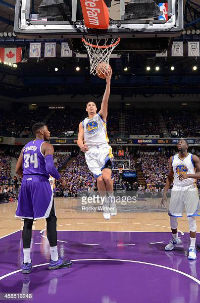 Klay Thompson of the Golden State Warriors shoots a layup against the Sacramento Kings on October 29 2014 at Sleep Train Arena in Sacramento...