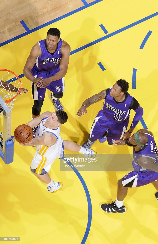<a gi-track='captionPersonalityLinkClicked' href=/galleries/search?phrase=Klay+Thompson&family=editorial&specificpeople=5132325 ng-click='$event.stopPropagation()'>Klay Thompson</a> #11 of the Golden State Warriors shoots a layup against the Sacramento Kings on April 4, 2014 at Oracle Arena in Oakland, California.