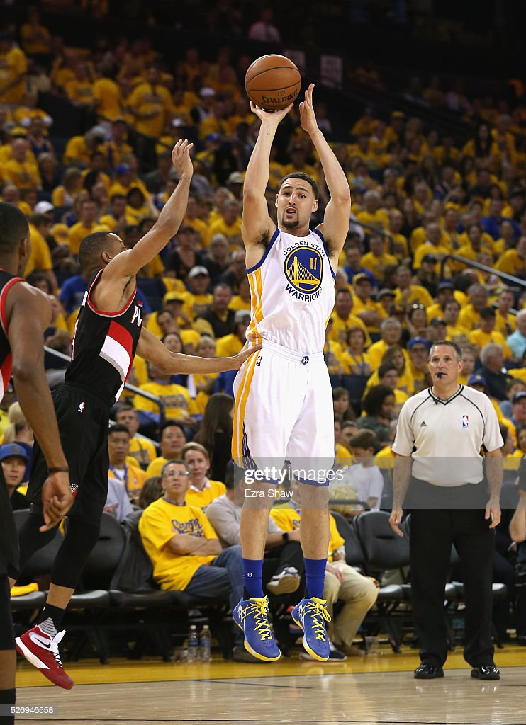Klay Thompson #11 of the Golden State Warriors shoots a three-point basket against the Portland Trail Blazers during Game One of the Western Conference Semifinals for the 2016 NBA Playoffs at ORACLE Arena on May 01, 2016 in Oakland, California.