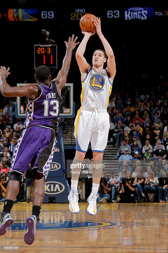Klay Thompson #11 of the Golden State Warriors shoots a three-pointer against Tyreke Evans #13 of the Sacramento Kings on March 6, 2013 at Oracle Arena in Oakland, California.