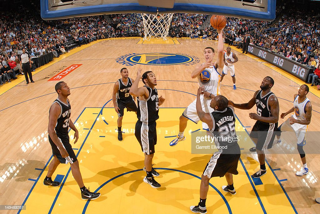 <a gi-track='captionPersonalityLinkClicked' href=/galleries/search?phrase=Klay+Thompson&family=editorial&specificpeople=5132325 ng-click='$event.stopPropagation()'>Klay Thompson</a> #11 of the Golden State Warriors shoots against James Anderson #25 of the San Antonio Spurs on April 26, 2012 at Oracle Arena in Oakland, California.