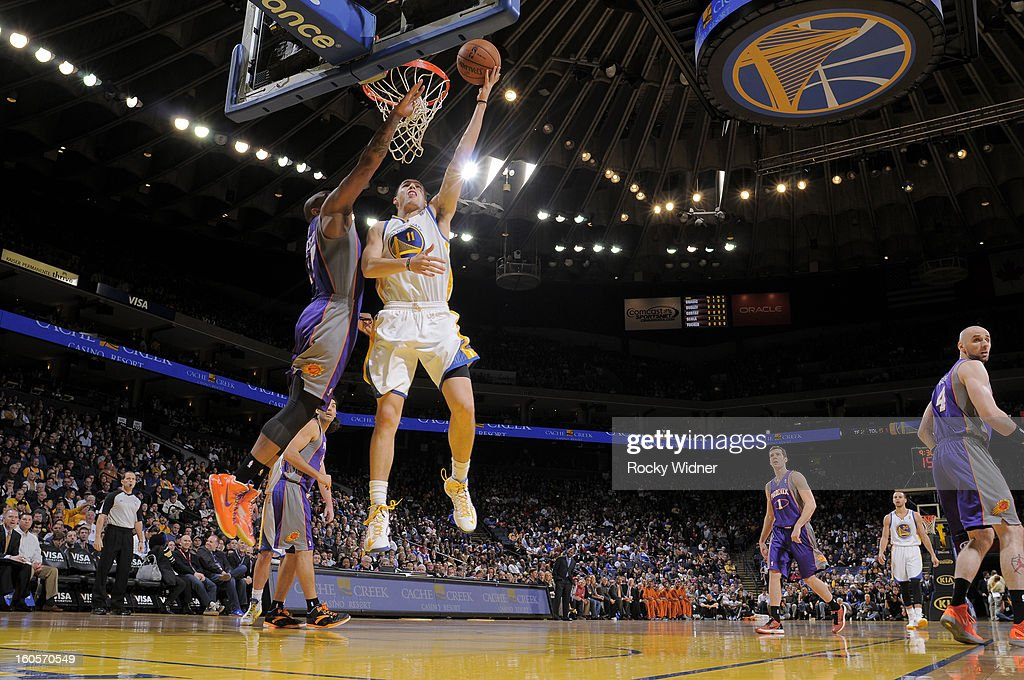 Klay Thompson #11 of the Golden State Warriors shoots against P.J. Tucker #17 of the Phoenix Suns on February 2, 2013 at Oracle Arena in Oakland, California.