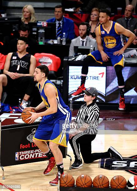 Klay Thompson of the Golden State Warriors shoots as teammate Stephen Curry looks on in the Foot Locker ThreePoint Contest during NBA AllStar Weekend...