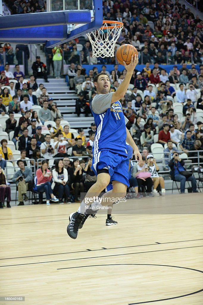 Klay Thompson of the Golden State Warriors shoots during Fan Appreciation Day as part of the 2013 Global Games on October 17, 2013 at the Oriental Sports Center in Shanghai, China.