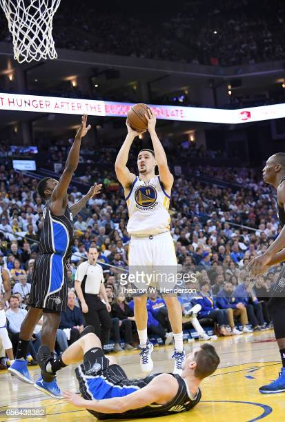 Klay Thompson of the Golden State Warriors shoots over Jeff Green of the Orlando Magic during an NBA basketball game at ORACLE Arena on March 16 2017...