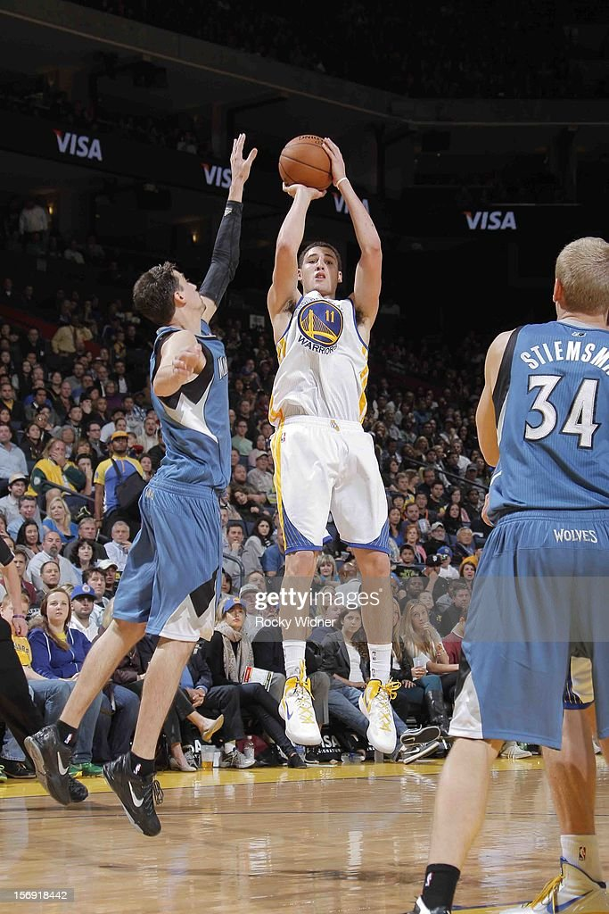 Klay Thompson #11 of the Golden State Warriors shoots the ball against Alexey Shved #1 of the Minnesota Timberwolves on November 24, 2012 at Oracle Arena in Oakland, California.