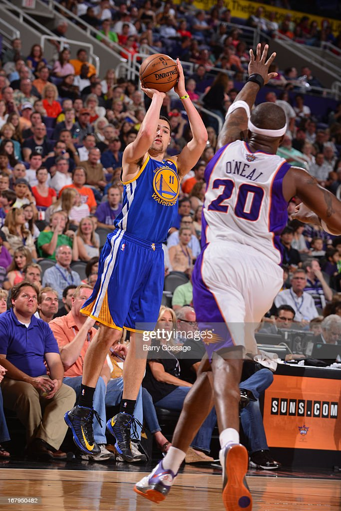 <a gi-track='captionPersonalityLinkClicked' href=/galleries/search?phrase=Klay+Thompson&family=editorial&specificpeople=5132325 ng-click='$event.stopPropagation()'>Klay Thompson</a> #11 of the Golden State Warriors shoots the ball against the Phoenix Suns on April 5, 2013 at U.S. Airways Center in Phoenix, Arizona.